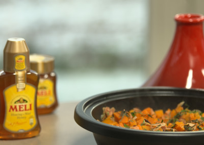 Tajine van pompoen met honing en amandelen